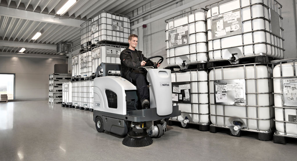 Floor Cleaning - Sweeper in Warehouse